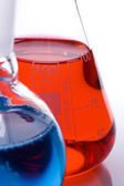 Blue and red flasks — Stock Photo