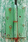 Old hinges on the wooden boards — Stock Photo