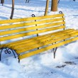 Yellow bench in winter park — Stock Photo