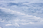 Snow hummocks on the ice — Stock Photo