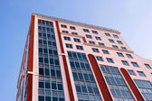 Building against blue sky — Stock Photo