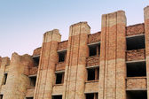 Collapsing unfinished brick building — Stock Photo