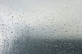Drops of dew on a transparent surface — Stock Photo