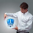 Stock Photo: Businessman holding virtual shield sign