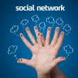 Happy group of finger smileys with social network sign and icons — Stock Photo
