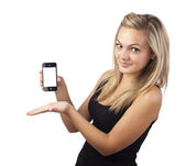 Young girl holding smartphone in her hand — Stock Photo