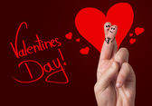 Painted finger smiley, valentine's day — Stock Photo