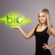 Woman holding virtual eco sign — Stock Photo