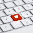 Keyboard with heart sign - Stok fotoğraf