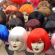 Wigs on mannequins - Stock Photo