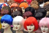Wigs on mannequins — Stock Photo