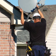 Satellite dish worker — Stock Photo