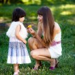 little girl with her ??mother with dandelions — Stock Photo