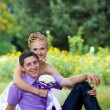 Bride and groom with a bouquet of looking at each other — Stock Photo #10347081