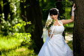 Beautiful bride in the woods — Stock Photo