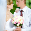 Bride and groom with a bouquet — Stock Photo #8612629