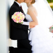 Bride and groom kissing — Stock Photo #8612659