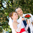 Bride and groom looking somewhere — Stock Photo