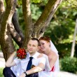 Portrait of the groom and the bride in park — Stock Photo
