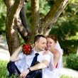 Stock Photo: Portrait of the groom and the bride in park