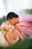 Bride and groom with a bouquet of kisses on the nature — Stock Photo