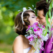 Bride and groom in the park — Stock Photo #8871549