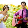 Portrait of bride and groom on sunflower field — Stock Photo #8871557
