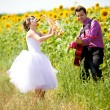 Stock Photo: Portrait of bride and groom on sunflower field