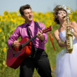 Portrait of bride and groom on sunflower field — Stock Photo #8871566