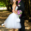 Bride and groom in the park — Stock Photo #8871567