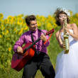 Portrait of bride and groom on sunflower field — Stock Photo #8871572