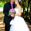Bride and groom in the park — Stock Photo #8871573