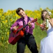 Portrait of bride and groom on sunflower field — Stock Photo #8871574