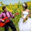 Royalty-Free Stock Photo: Portrait of bride and groom on sunflower field