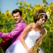 Portrait of bride and groom on sunflower field — Stock Photo