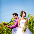 Portrait of bride and groom on sunflower field — Stock Photo #8871584