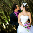 Bride and groom in the park — Stock Photo #8871587