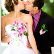 Bride and groom in the park — Stock Photo #8871599