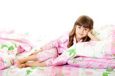 A little girl lying on the bed — Stock Photo