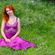 Ginger girl in purple dress - Stock Photo