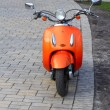 Orange scooter - Stock Photo