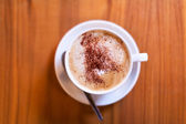 Coffee shallow depth of field on table — Stock Photo