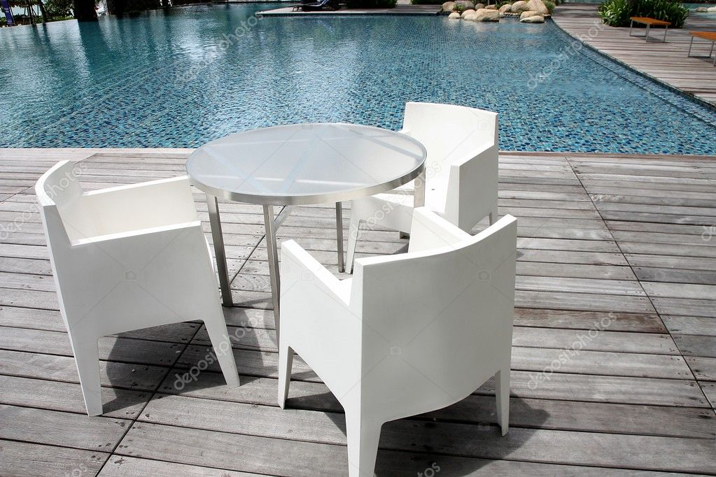 The white chair near the pool. — Stock Photo #10043456