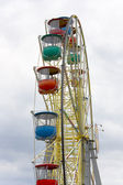 Ferris wheel against a background of clouds — Stock Photo