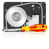 Computer hard disk drive and screwdriver. — Stock Photo