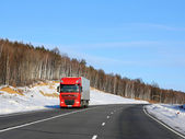 The red truck on a winter road. — Stock Photo