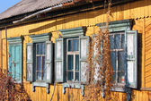 Old dirty windows on old wall — Stock Photo