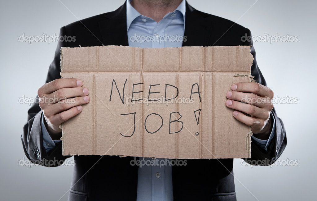 "Young businessman holding cardboard with ""need a job"" text on it — Stock Photo #10058305"