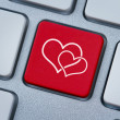 Online love, two hearts symbol at the computer key — Foto Stock