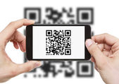 Scanning QR code with smart phone — Стоковое фото